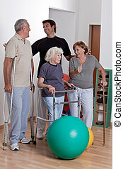Happy Male Physical therapist with patient .
