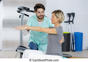 male physio therapist with female patient