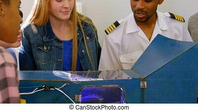 Male pilot explaining about machine to kids 4k - Male pilot...