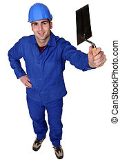 Male plasterer standing with tool