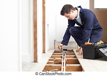 Male Plumber Fitting Central Heating System
