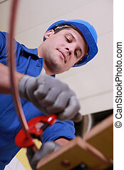 Male plumber using clamp