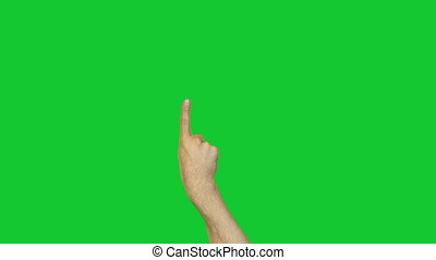 Male pointing forefinger on green background - Footage of...