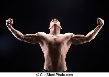 Male power - Image of shirtless man looking upwards with ...