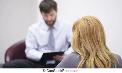 male psychologist and his female patient during therapy. Receiving psychologist
