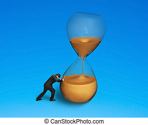 male pushing tilt hourglass isolated on blue
