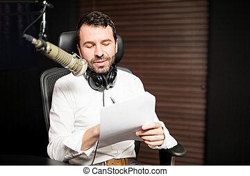 Male radio presenter hosting a talk show on air