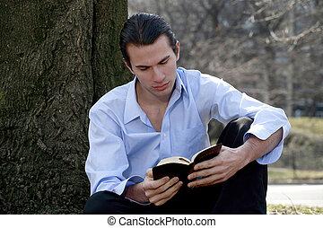 Male reading Bible - Man reading Bible.