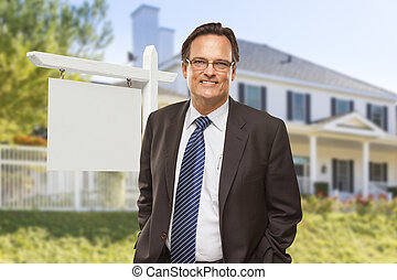 Male Real Estate Agent in Front of Blank Sign and House