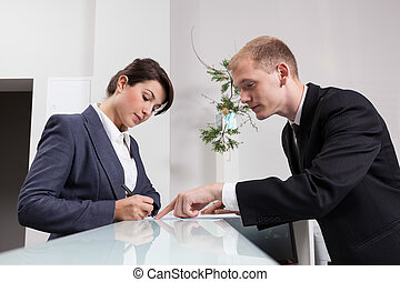 Male receptionist during work