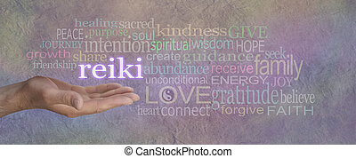 Man's hand, open with the word 'REIKI' floating above, surrounded by a healing relevant word cloud on a grey lilac stone effect background wide banner