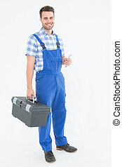 Male repairman carrying toolbox