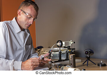 Male Researcher Wearing Safety Glasses - A researcher in a...