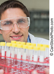 Male researcher  with at test tubes in the lab