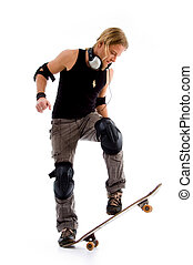 male riding on skate board