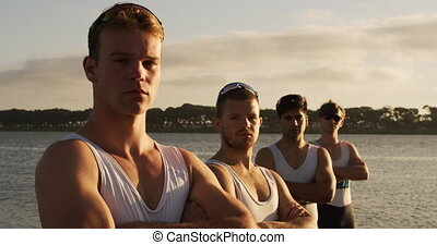 Male rower team looking at camera with arms crossed - Side ...