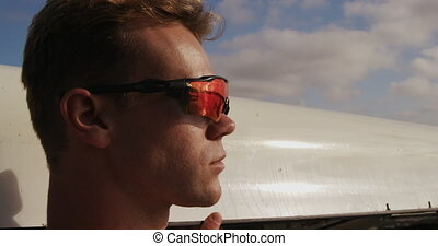 Male rower wearing sunglasses looking away - Side view close...