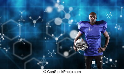 Male rugby player against blue background