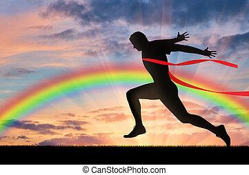 Male runner crosses the red tape