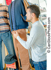 Male sales assistant in a clothes shop
