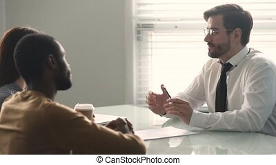 Male salesman bank manager consulting mixed ethnicity couple...