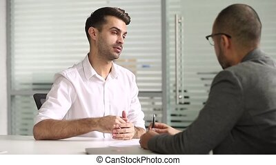 Male salesman talking with client handshaking closing deal...