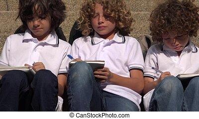 Male School Kids Writing
