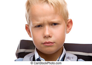 Male Schoolchild looks angry in camera