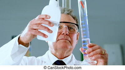Male scientist experimenting in laboratory 4k - Attentive ...