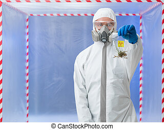 male scientist holding bag with biohazard symbol
