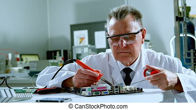 Male scientist soldering circuit board 4k - Male scientist ...
