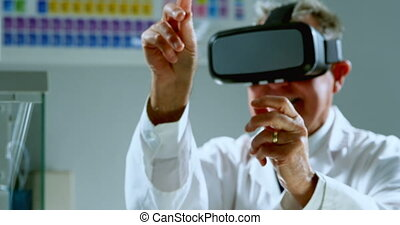 Male scientist using virtual reality headset 4k
