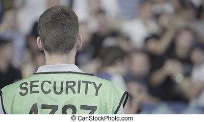 Male security guard in a stadium during a football soccer ...