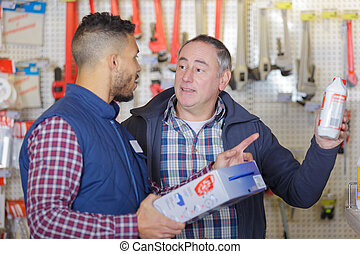 male seller advising client in hardware store