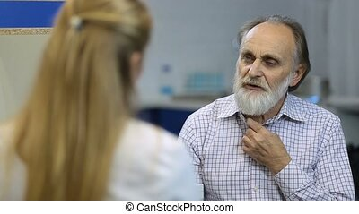 Male senior patient visiting a doctor at hospital