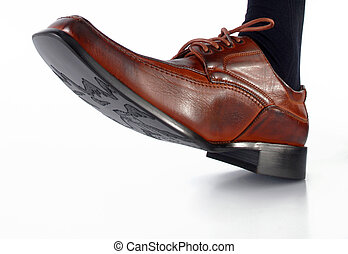 Male shoe stepping on white background. Close-up shot - Shoe...