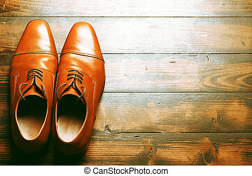 Male shoes - Men's leather shoes on a wooden floor