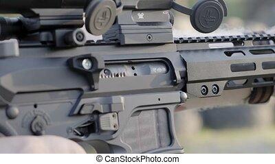 male shoots with a firearm, shotguns outdoors. - male shoots...