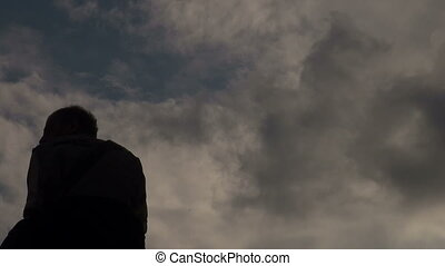 Male silhouette against the sky