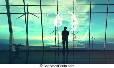 A male silhouette stands in an office with large windows overlooking the wind farms, surrounded by infographics.