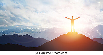 Male silhouette on sunrise background