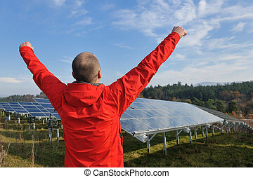 Male solar panel engineer at work place - Male engineer at ...