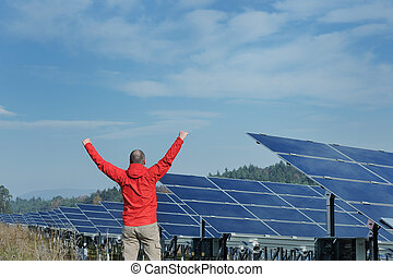 Male solar panel engineer at work place
