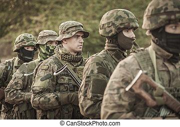 Male soldiers in battle uniforms