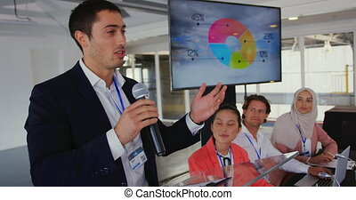 Male speaker addressing the audience at a business conference