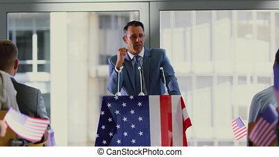 male speaker speaks in a political campaign seminar at ...