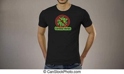 Male standing t-shirt sign stop corona virus quarantine - ...