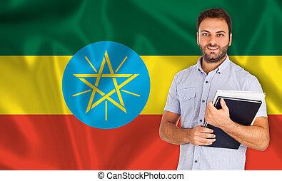 Male student of languages on Ethiopian flag