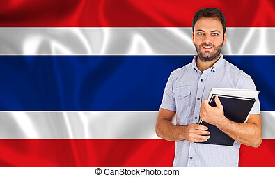 Male student of languages on Thai flag