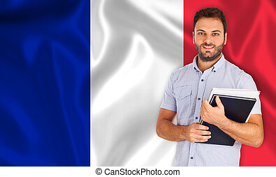 Male student over French flag - Smiling young male student...